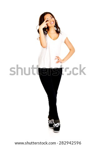 Happy african teenager woman showing victory sign - stock photo