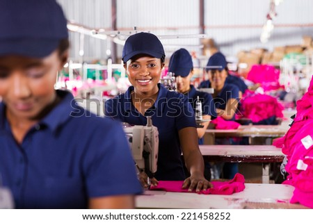 happy african textile workers on the production line - stock photo