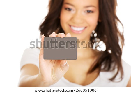 Happy african woman holding a card. - stock photo