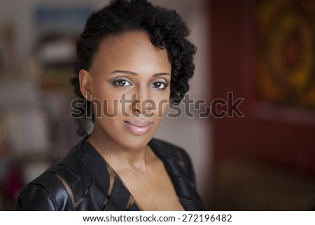 Happy African Woman Smiling At The Camera - stock photo
