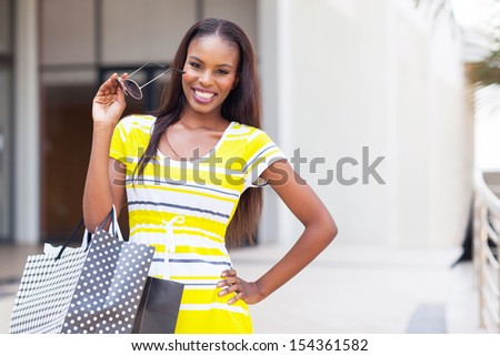 happy afro american woman in shopping mall - stock photo
