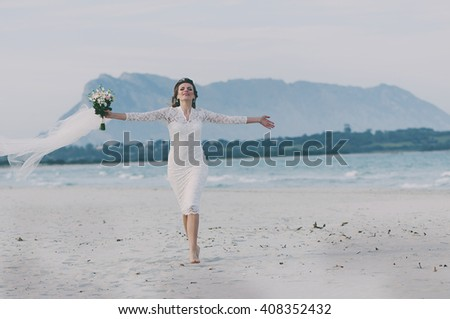 Happy amazing young woman in wedding dress, selective focus