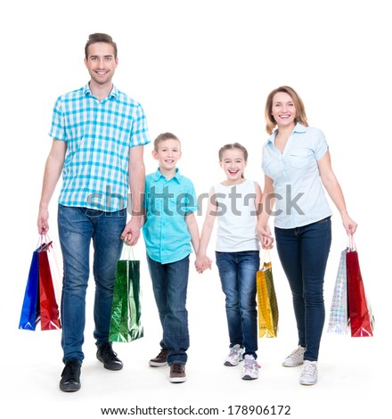 Happy american family with children holding shopping bags - over white background - stock photo