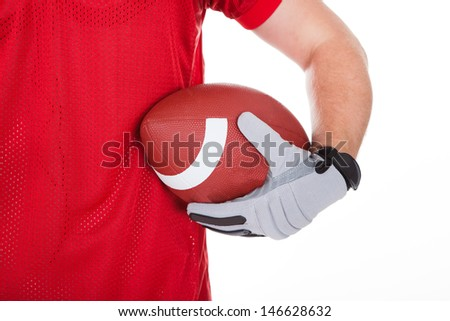 Happy American Football Player Holding Rugby Over White Background - stock photo
