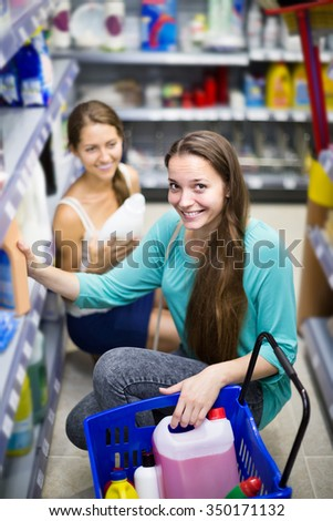 happy american  people choose some detergents in the shop - stock photo