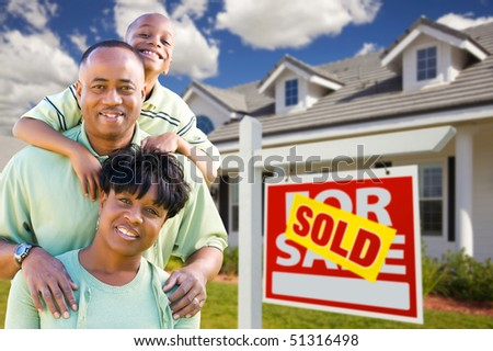 Happy and Attractive African American Family with Sold For Sale Real Estate Sign and House. - stock photo