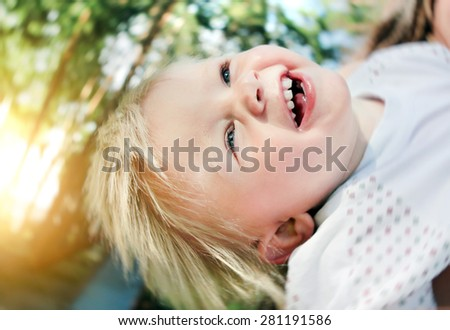 Happy and Cheerful Child in the Summer Park - stock photo