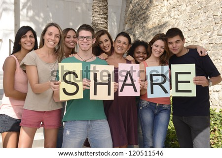 Happy and diverse group holding sign with letters Share