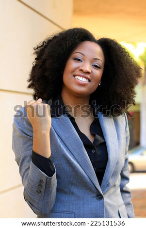 Happy and Excited Professional Attractive African American Business Woman Person Black Hair Expression YES Fist Pump - stock photo