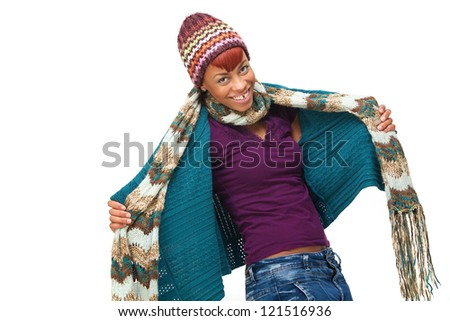 Happy and fun young African woman smiling and wearing winter clothes. She is opening her sweater and is isolated on white background - stock photo