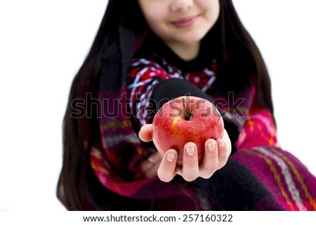 Happy and Healthy, natural organic portrait of attractive smiling girl holding green apple in her hand over blue background - stock photo