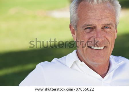 Happy and healthy senior man sitting outside smiling and happy - stock photo