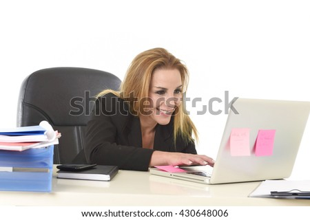 happy and relaxed 40s businesswoman with blond hair smiling confident sitting on office chair working at laptop computer in female business success concept isolated white background