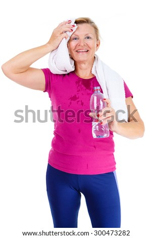 Happy and smile old senior woman in sport outfit marsala color with white towel on her neck, hold water bottle in hand and mop one's brow after fitness exercises, isolated on white background - stock photo