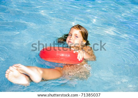 happy and smiling children in the pool - stock photo