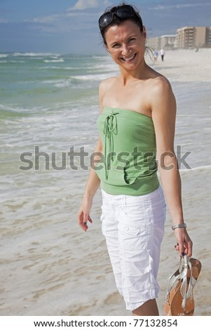 Happy and Smiling Girl on the Florida Beach - stock photo