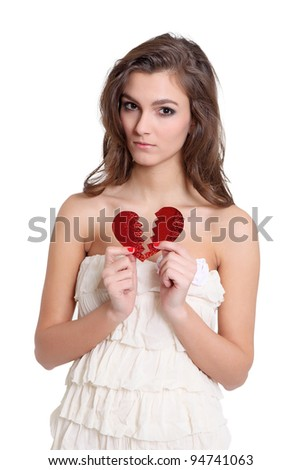 Happy and smiling girl standing with a heart symbol - stock photo