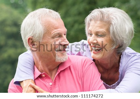 Happy and smiling senior couple in love - stock photo
