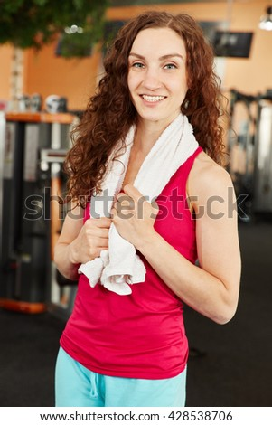 Happy and sporty woman training at the gym - stock photo