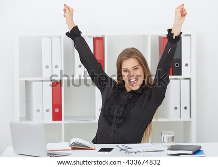 Happy and successful businesswoman 