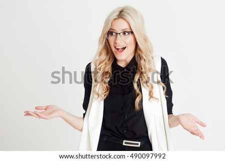 Happy and surprised young confident business lady, looking at camera, white background. Place for you text on the right