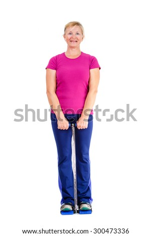 Happy and white teeth smile old senior woman in sport outfit marsala color doing fitness exercises, isolated on white background, Positive human emotions - stock photo