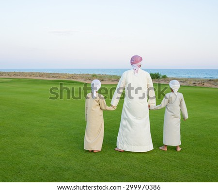 Happy Arabic family on summer vacation - stock photo
