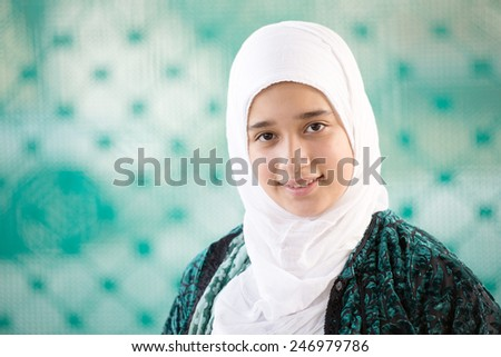 Happy Arabic Muslim Middle Eastern girl - stock photo