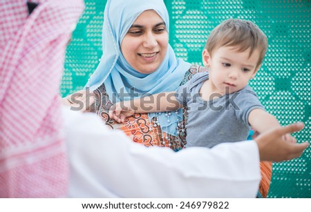Happy Arabic Muslim Middle Eastern Gulf family - stock photo