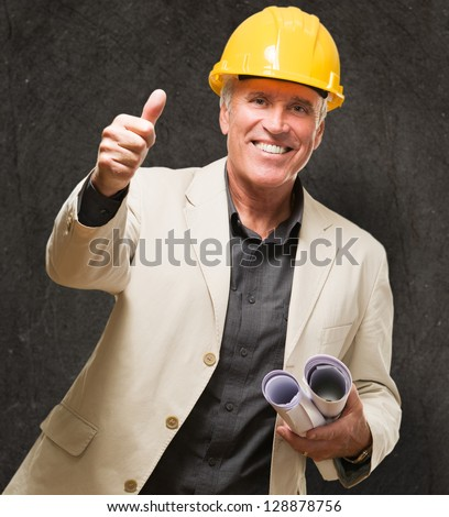 Happy Architect Man Showing Thumb Up Sign against a grunge background - stock photo