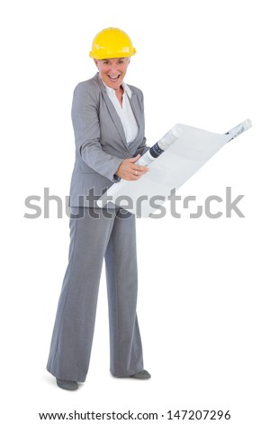 Happy architect with plan wearing hardhat on white background