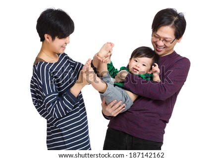 Happy asia family playing with baby boy - stock photo
