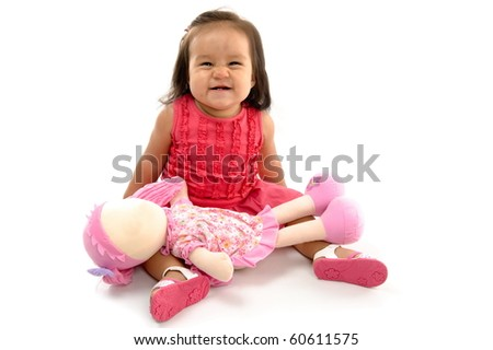 Happy asian baby holding a plush doll.
