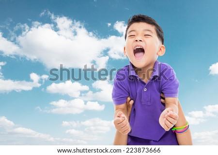 Happy Asian boy isolated on sky background.  - stock photo