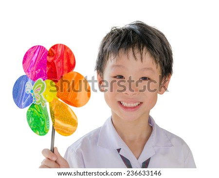 Happy Asian boy with colorful weathercock isolated on white background - stock photo