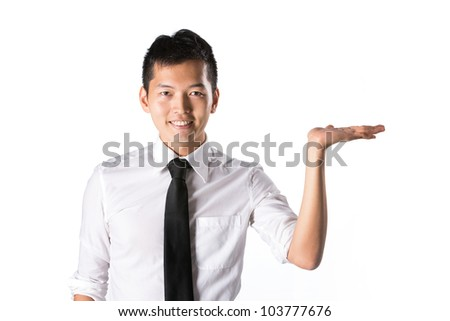 Happy Asian business man holding out his hand with room left for your message.
