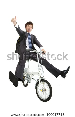 Happy asian  businessman on a bicycle isolated on white background - stock photo