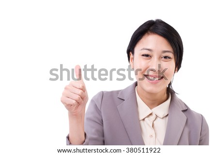 happy asian caucasian business woman giving thumb up hand gesture - stock photo