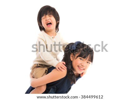 Happy asian child sister and brother while playing on white background isolated.