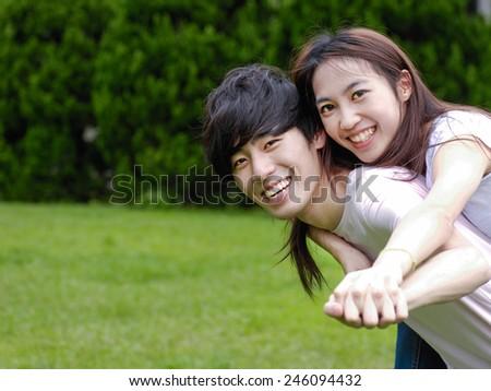 Happy Asian couple in love. - stock photo