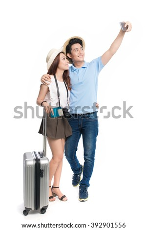 Happy asian couple with luggage taking pictures Isolated on white background. - stock photo