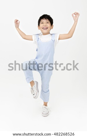 Happy asian cute boy with smile face on gray background