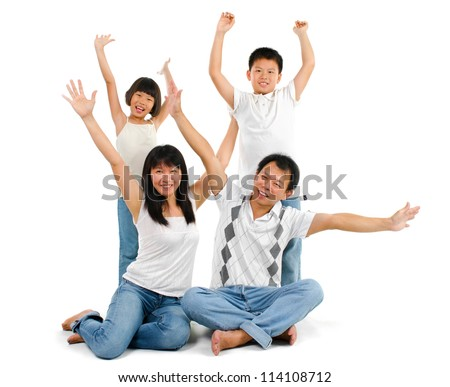 Happy Asian family arms up over white background - stock photo
