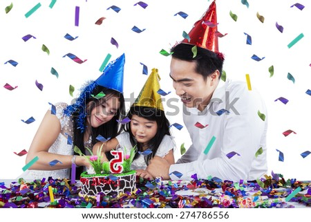 Happy asian family celebrate birthday party and cutting birthday cake together, isolated on white - stock photo
