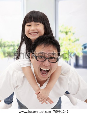 happy asian family. father and little girl - stock photo