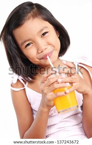 Happy asian girl drinking an orange juice. - stock photo