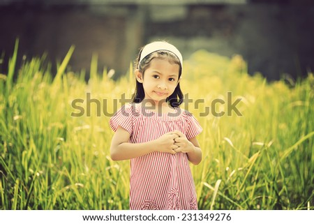 Happy asian girl playing outdoor in sunny day with retro style
