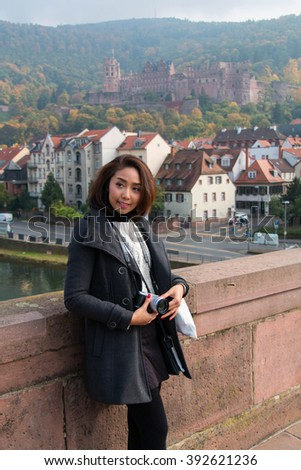 Happy Asian Girl, Travel in Europe, Germany, Heidelberg - stock photo