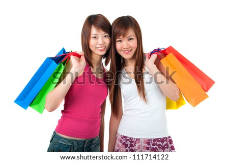 happy asian girls shopping with bags - stock photo