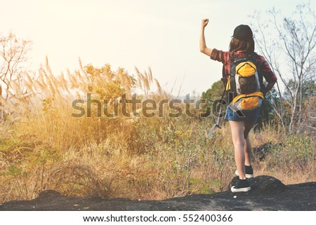 Happy Asian hipster women backpack in nature background, Relax time on holiday concept travel , color of vintage tone and soft focus